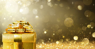 Christmas Present With Golden Sparkling stock images