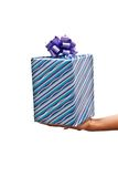 Christmas present on the hand Royalty Free Stock Photos