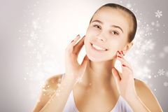 Christmas present- healthy shining skin,grey background stock photo