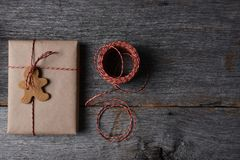 Christmas Present with a Holiday Shaped Cookie Royalty Free Stock Photography