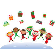 Christmas present and jumping children Stock Photos