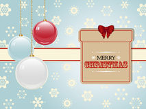 Christmas present label and baubles Stock Photography