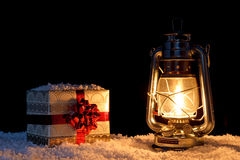 Christmas present and lantern Stock Images