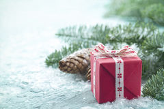 Christmas present on a light blue background Royalty Free Stock Image