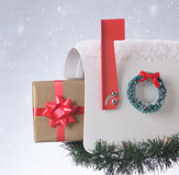 Christmas present in Mailbox isolated Royalty Free Stock Image