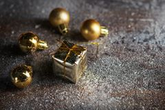 Christmas present mini golden boxes in the snow background. Close up. Christmas holiday celebration and new year concept. Winter royalty free stock images
