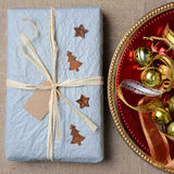 Christmas Present and Ornaments Royalty Free Stock Images