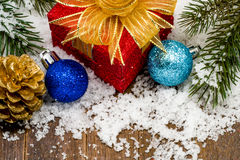 Christmas present and ornaments on snow Stock Photography