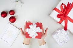 Christmas present on palms Stock Image