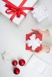 Christmas present on palms Stock Photography