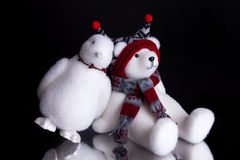 Christmas present with a penguin leaning on polar bear Royalty Free Stock Images