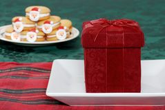 Christmas present on plate with cookies background Royalty Free Stock Image