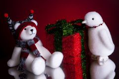 Christmas present with a polar bear and a penguin Royalty Free Stock Image