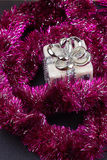 Christmas present with purple garland. A close-up Stock Images