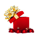 Christmas Present and Red Baubles Royalty Free Stock Photos