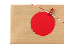 Christmas present with red blank gift tag Royalty Free Stock Image