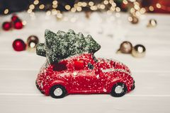 Christmas present. red car toy with christmas tree on top on whi Stock Photography