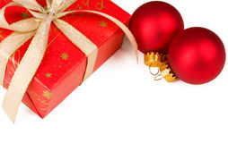 Christmas present and red ornaments Royalty Free Stock Photography