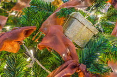 Christmas Present and Red Ribbons. Christmas Present Magical Moment - Stock Image, Christmas and New year Gift and Ornaments under green pine tree and ribons royalty free stock photo
