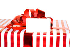 Christmas Present with Ribbon and tag. Isolated on white backgro Royalty Free Stock Images