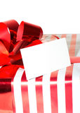 Christmas Present with Ribbon and tag. Isolated on white backgro Stock Photo