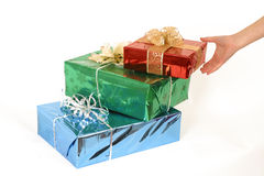 Christmas present's. A teen's hand going for the christmas present Royalty Free Stock Images