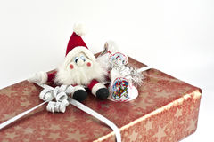 Christmas present with santa on top. Christmas present with a santa doll and some jingle bells on top Royalty Free Stock Photos