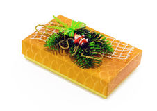 Christmas present with Santa on white. A yellow box decorated with pine, ribbons and Santa Royalty Free Stock Photos