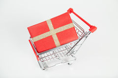 Christmas present in shopping cart Royalty Free Stock Images