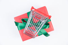 Christmas present and shopping cart Stock Photos