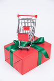 Christmas present and shopping cart Royalty Free Stock Images