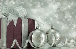 Christmas Present with Silver Baubles. Beautifully wrapped present with silver baubles Stock Photos