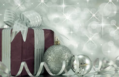 Christmas Present with Silver Baubles. Beautifully wrapped present with silver baubles Royalty Free Stock Image