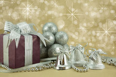 Christmas Present with Silver Baubles,bells and beads. Beautifully wrapped present with silver baubles,bells and beads Royalty Free Stock Photography