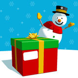 Christmas Present and Snowman Stock Photo