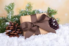 Christmas Present on a Snowy Surface royalty free stock photography