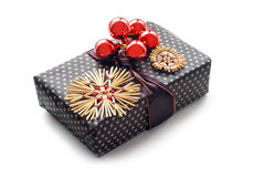 Christmas present with  straw stars and red baubles isolated wit Royalty Free Stock Photos