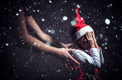 Christmas present suprise. Little  holding hands on her head and waithing for  present Royalty Free Stock Photo