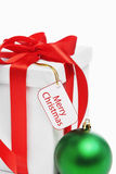 Christmas present with tag Royalty Free Stock Photos