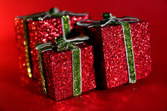 Christmas present. Three sparkling red boxes for Christmas Royalty Free Stock Image