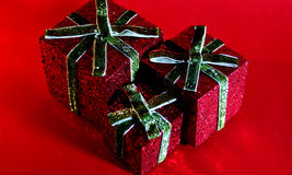 Christmas present. Three sparkling red boxes for Christmas Stock Photography