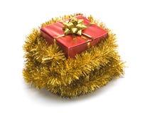 Christmas present on tinsel Stock Photography