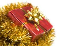 Christmas present and tinsel Stock Image