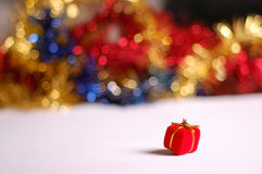 Christmas present and tinsel Stock Images