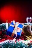 Christmas present and tinsel Stock Photos