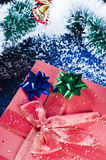 Christmas present and tinsel Royalty Free Stock Photos