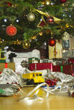 Christmas present unwrapped under a christmas tree Royalty Free Stock Images