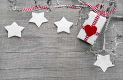 Christmas present for a voucher on a wooden background Stock Images