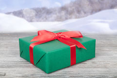Christmas present and winter landscape Royalty Free Stock Photos