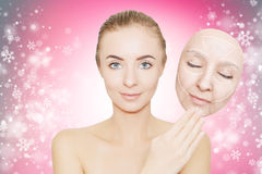 Christmas present: woman enjoys her healthy skin without wrinkle Royalty Free Stock Images